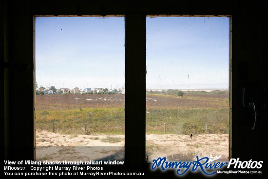 View of Milang shacks through railcart window