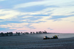 Harvester in the Mallee on sunset in Victoria