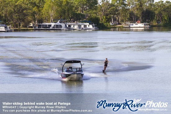 Water skiing behind wake boat at Paringa